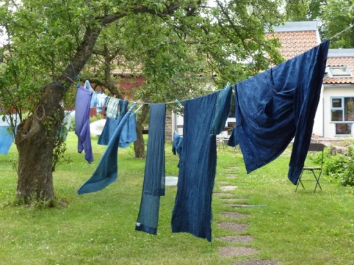 Indigo dyed fabric and clothes drying on a washing line