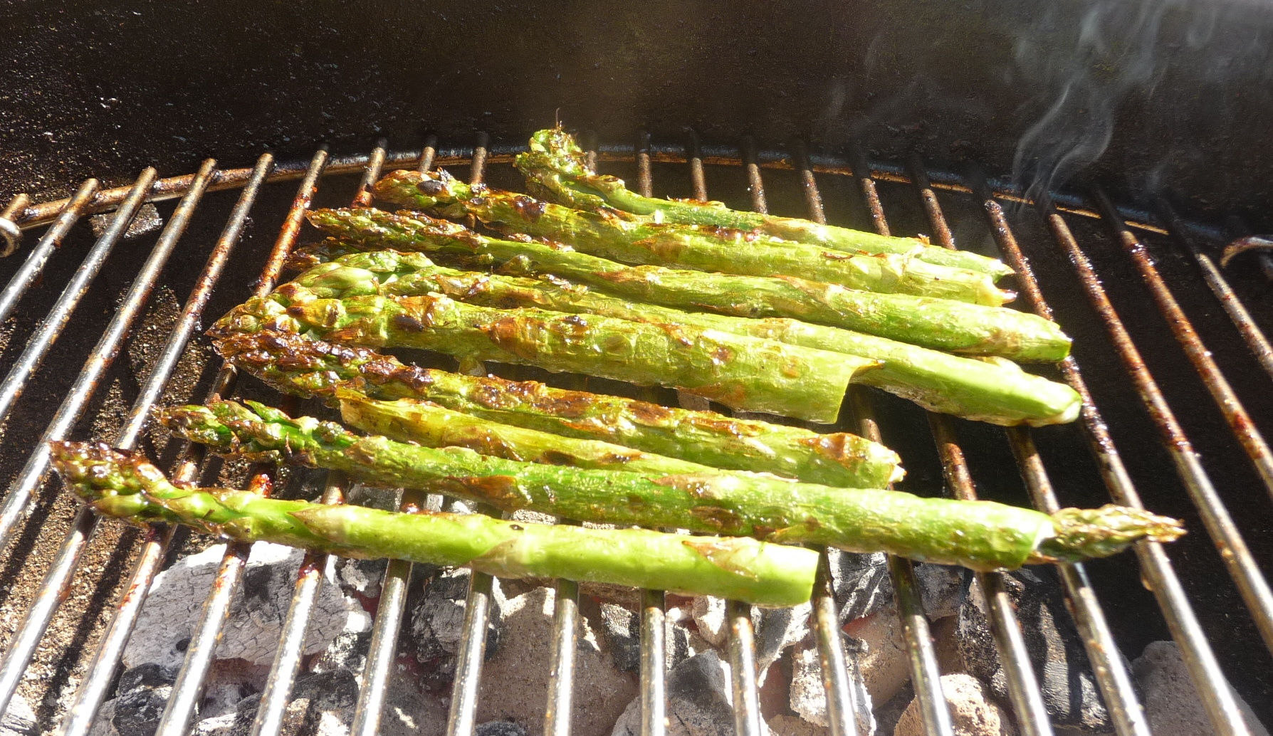 caramelised asparagus smoking on the bbq