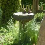 stone birds on stone birdbath