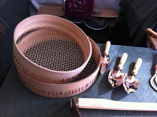 copper garden tools and sieve