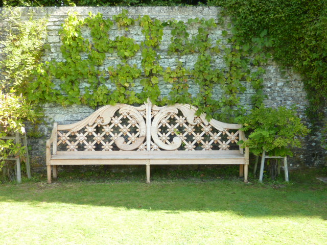 wooden bench in garden