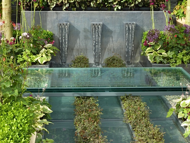 Captivating Water Spouts With Lush Planting