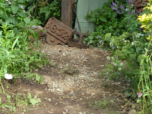 a handmade path in a cottage garden