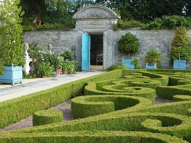 large wooden planters in formal garden