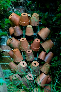 garden pots on an old bottle stand make an interesting garden feature