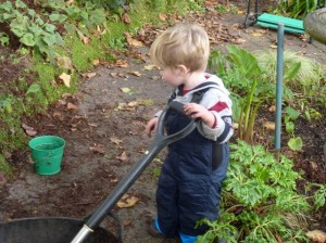 young boy helps with gardening