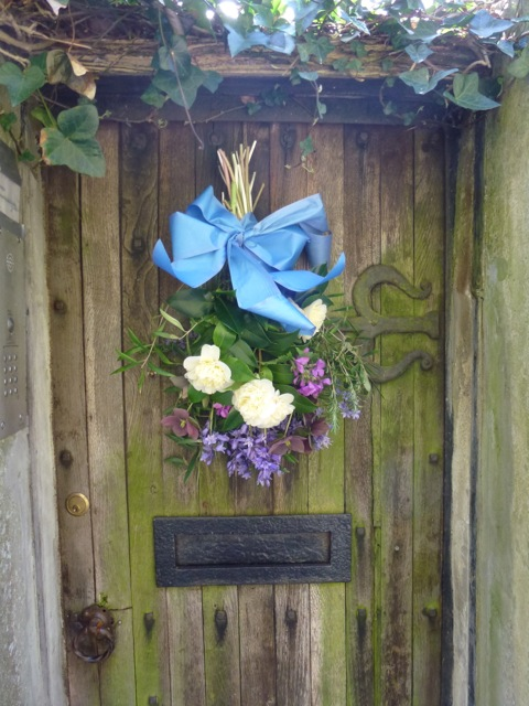 flowers hanging on rustic door