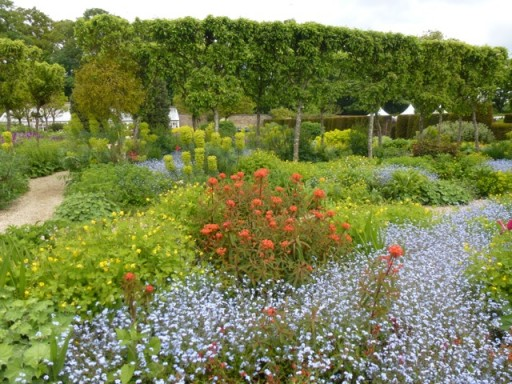 verdant green borders punctuated by vibrant flowers