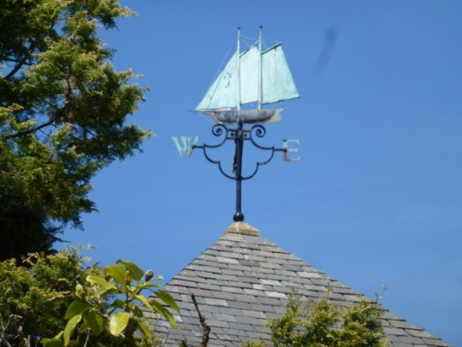 Beautiful copper weather vane of sailing boat