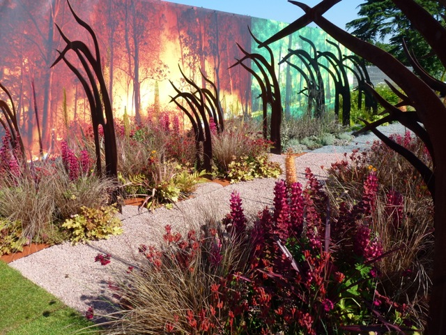 modern sculptures with flaming backdrop