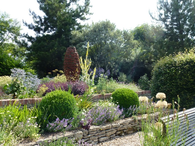 more gravel paths flanked by stone walls and planting