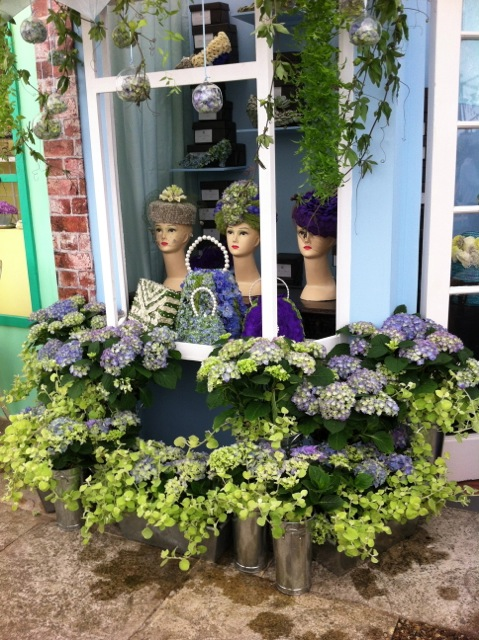 Impressive and colourful floral display of a hat shop