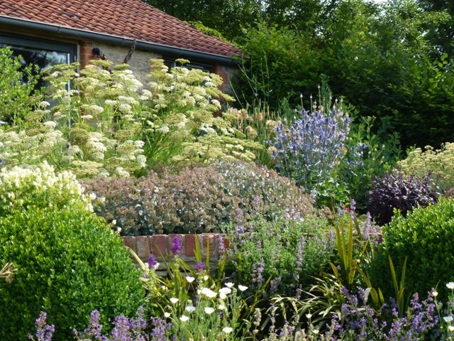 mature garden borders at their peak