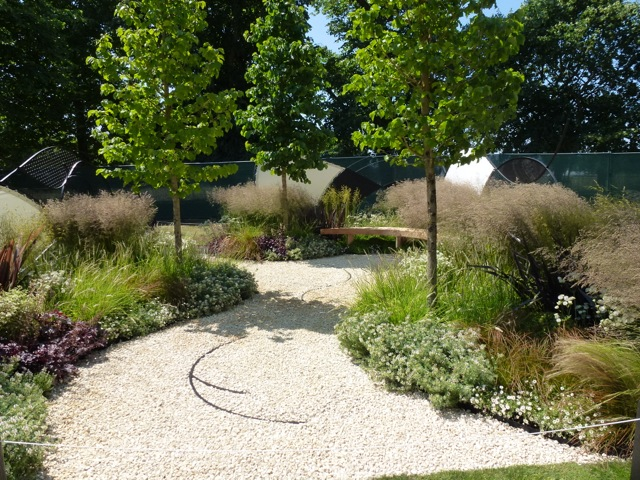 flowing planting along curving path
