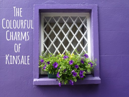 purple painted house with purple flowers on window sill