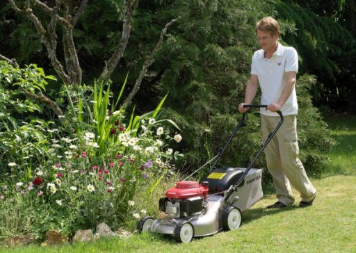 honday izy being used to mow lawn