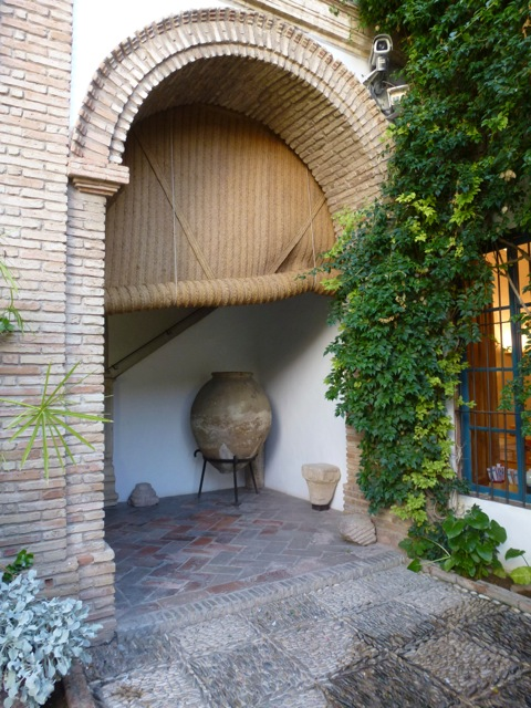 archway and pot in courtyard garden