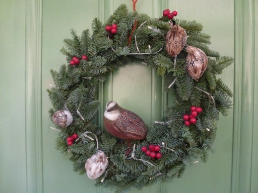 christmas wreath with bird sat on it