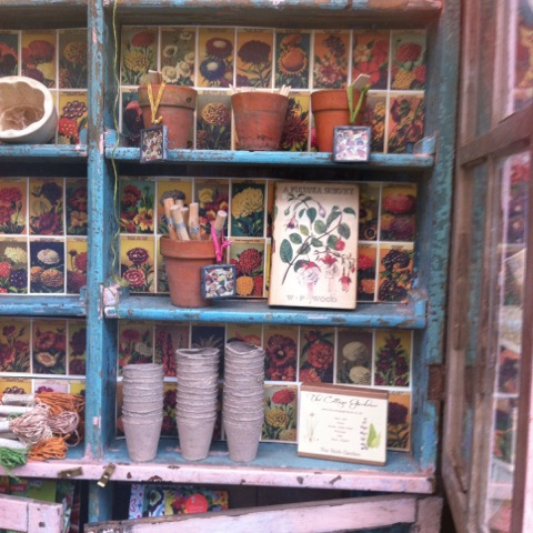 old pots on painted wooden shelves