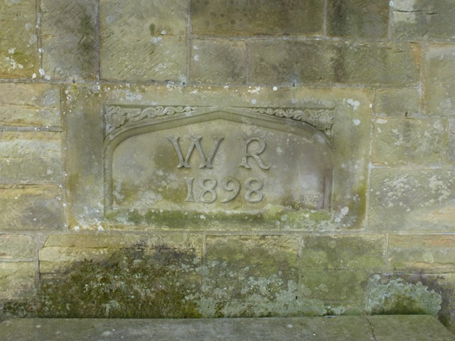 carved date and initials in the walled garden built by William Robinson
