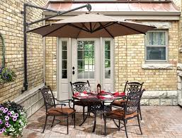 a set of garden furniture under a parasol