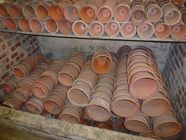 very neatly stacked pots in a garden shed