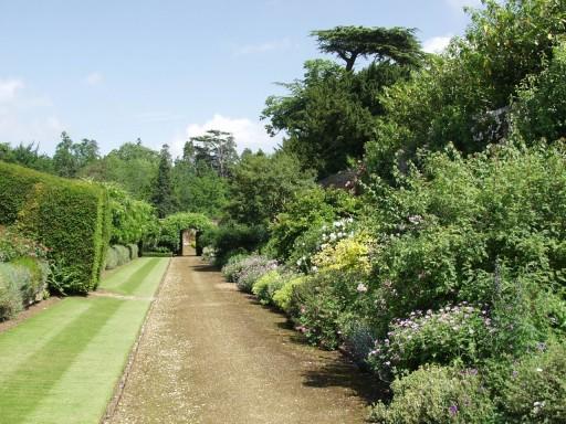 a pathway runs through the walled garden at Boxwood