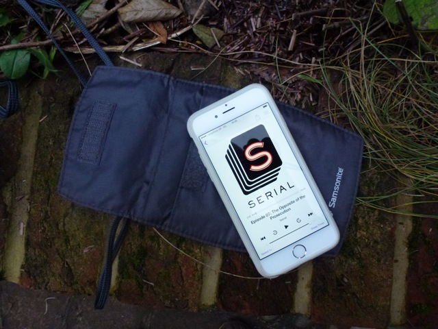 listening to a podcast on the iphone in the garden