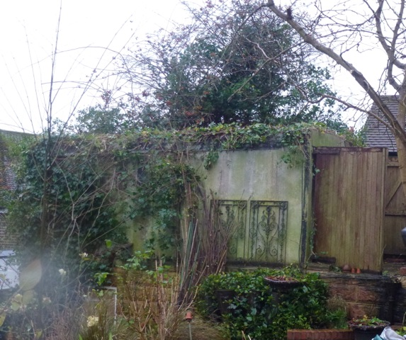 old dilapidated garage in garden