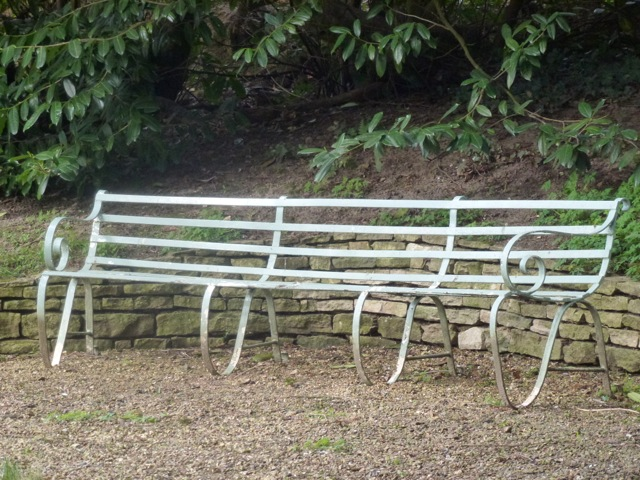 curvy iron bench at Woolbeding