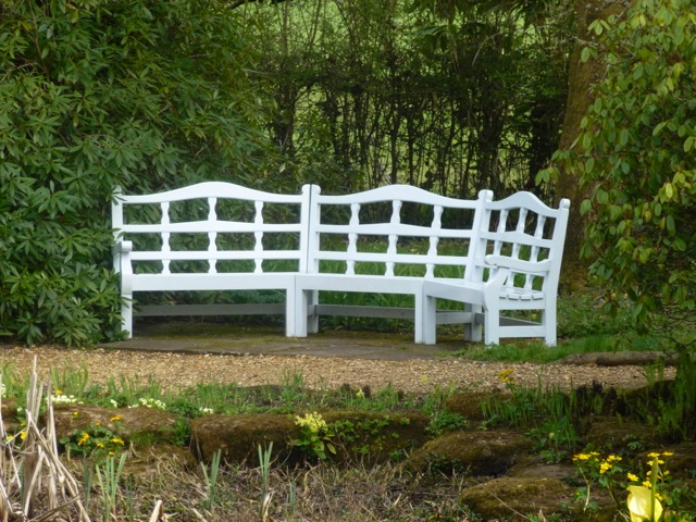 a sociable wooden bench arrangement