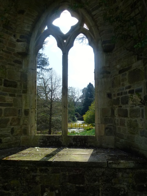 view of bridge through old church window