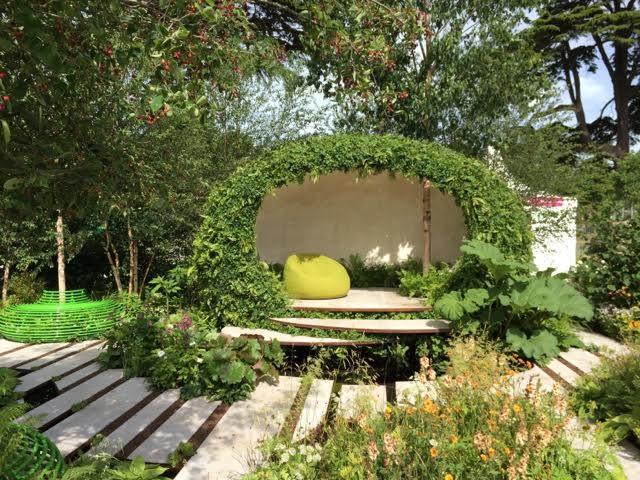 pod-like building clad in greenery