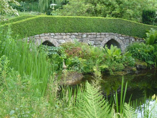 stone bridge by a pond in french garden