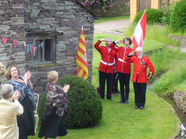 cast salute the audience in Arne Maynard's garden