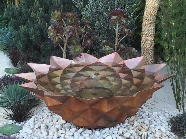 Copper bowl echoing a Fibonacci number in the Beauty of Mathematics Garden