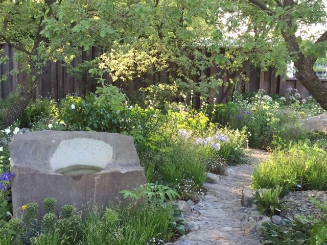 Cleve West's M&G Garden that recalls the Exmoor of his youth with stunted oaks, craggy rocks and a gentle palette of ferns and flowers